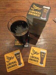 Liberal Drinks Beermats and a pint of beer